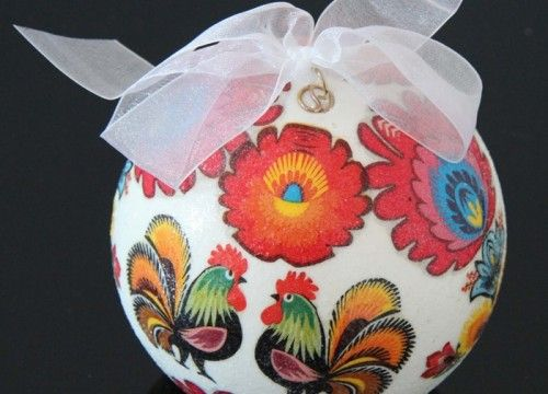 A big white Christmas ball with a colourful pattern
