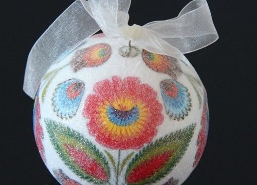 A medium-sized white Christmas ball with a colourful pattern