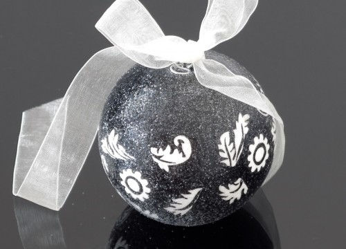 A small black and white glass ball
