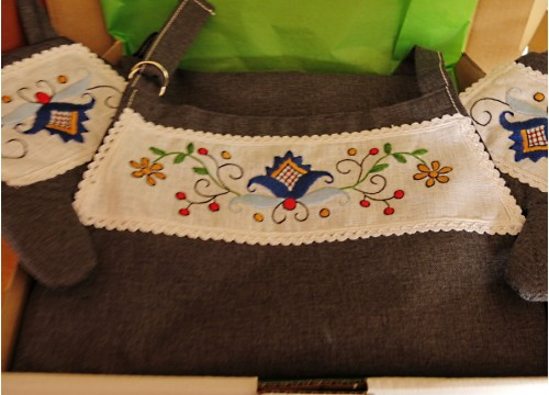 An apron and gloves - a dark blue flower