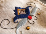 An apron and gloves - a dark blue flower