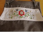 An apron and gloves - a red flower