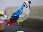 Oiseau sur un support