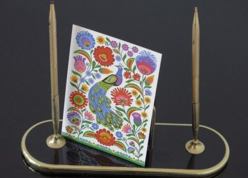 A printed postcard with a peacock