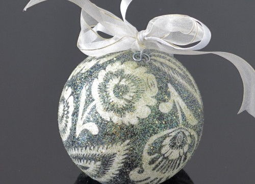 A small dark green Christmas ball