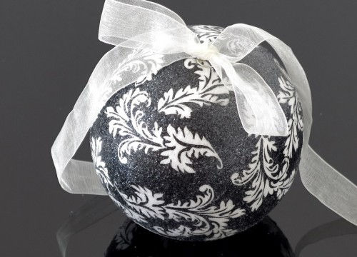 A medium-sized white and black Christmas ball