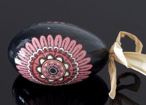 Black decorated egg with a raspberry flower (created on a goose eggshell)