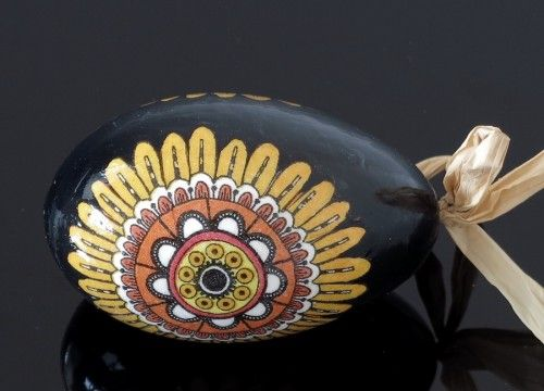 Black decorated egg with a yellow flower (created on a goose eggshell)