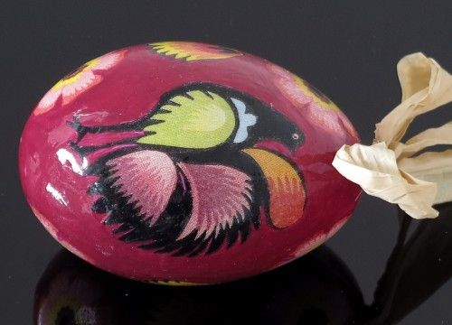 Black decorated egg with a cock magenta (created on a goose eggshell)