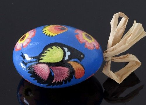 Black decorated egg with a blue cock (created on a goose eggshell)