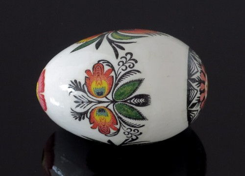 Black decorated egg with flowers (created on a goose eggshell)