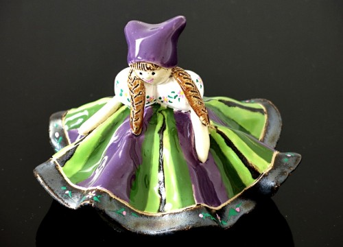 A bell doll (purple and green)