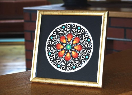 Łowicz paper cut-out in a golden frame (black passe-partout)